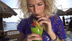 SLOW MOTION: Attractive female drinking a cocktail Stock Footage