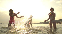 SLOW MOTION: Playful women playing with sea water Stock Footage