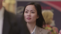 Attractive young asian woman walking alone in a crowd Stock Footage