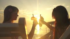 SLOW MOTION: Young women toasting at sunset Stock Footage