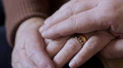 Man comforts elderly woman Stock Footage