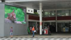 People walking in front of a gas station. Santos, Sao Paulo, Brazil. 81 Stock Footage
