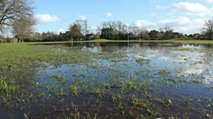 Great Britain flooding. Dolly of flooded soccer pitch Stock Footage