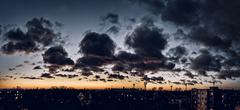 cloudscape over the city at sunset - stock photo