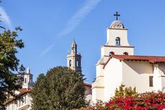 steeples white adobe mission santa barbara cross bell bougainvillea californi - stock photo