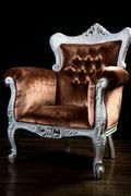vintage velvet brown color armchair with carved legs - stock photo
