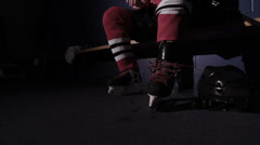 Team Sport - Ice Hockey - Player Lacing up Skates Stock Footage