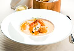 thai shrimp cream soup with scallops and tiger prawns - stock photo