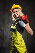 Attractive builder woman indoors Stock Photos