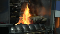 Cooking claypot chicken rice over gas stove in big flame (CLAYPOT--2A) Stock Footage