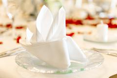 close-up photo of folded napkin on a table at restaurant - stock photo