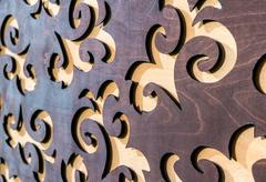 carved wooden background, beige and brown colors - stock photo