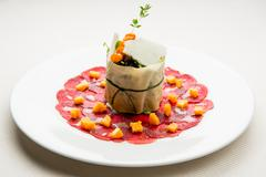 venison carpaccio with sea buckthorn marmalade and sprout salad - stock photo