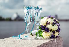 Champagne glasses and bridal bouquet Stock Photos