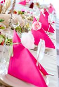 Wedding table decorations in pink and white colors, napkins close-up Stock Photos