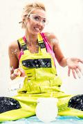 Female construction worker with can of paint and paint brush Stock Photos