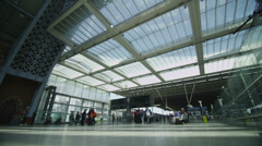 Travelers and commuters passing through London's St. Pancras railway station Stock Footage