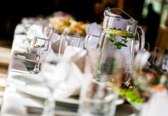 table with crockery at restaurant close-up - stock photo