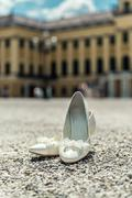White bridal elegant shoes outdoors Stock Photos