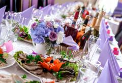 Wedding table decorations with food and beverages Stock Photos