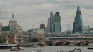 London's River Thames with St. Paul's Cathedral and the City behind Stock Footage