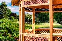 outdoor wooden gazebo over summer landscape background - stock photo