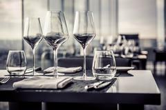 Empty glasses in restaurant Stock Photos
