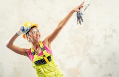 Stock Photo of female construction worker posing over white obsolete background