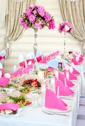wedding table decorations in pink and white colors - stock photo