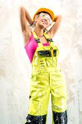 female construction worker posing indoors - stock photo