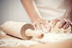 Woman kneading dough, close-up photo Stock Photos