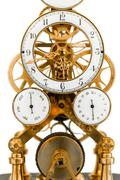 Vintage clock in golden and white colors Stock Photos