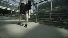Businesswoman walking through St. Pancras railway station in London Stock Footage