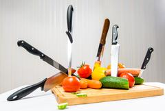vegetables and knifes, weight loss concept - stock photo