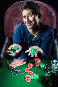 poker player holding poker chips - stock photo
