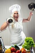 Angry and stressed out woman cook Stock Photos