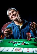 cheerful poker player - stock photo
