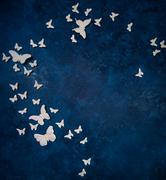 white small and big artificial butterflies - stock photo