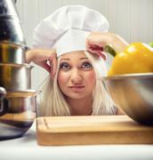 Portrait of overworked woman cook Stock Photos