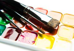 Watercolor paintbox and paintbrushes close-up Stock Photos
