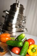 Raw vegetables and kitchen utensil close-up Stock Photos
