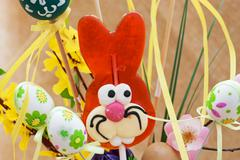 Lollipop-shaped easter bunny with eggs Stock Photos
