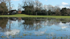 Dolly towards goal post on flooded pitch Stock Footage