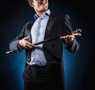 Stock Photo of man in elegant black jacket and blue shirt holding cane