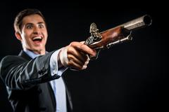 man with musket, selective focus - stock photo