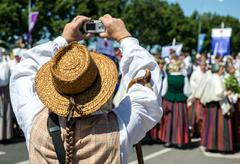 Man in latvian national costume take a photo Stock Photos