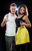 young attractive couple with glasses of sparkling champagne - stock photo