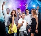 Stock Photo of cheerful group of young people dancing at party