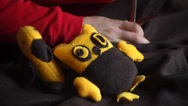 Stock Video Footage of man makes a soft toy