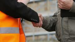 Construction people on site. They shake hands. Close up - stock footage